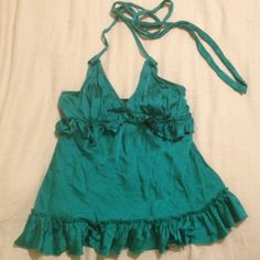 BCBG Silk Halter Top Beautiful teal halter top from BCBG, 92% silk, such a stunning top, beautiful ruffle under the bust and the tie around your neck allows you to adjust tighten/loosen as much as you need. All it needs is to be steamed/ironed. BCBG Tops