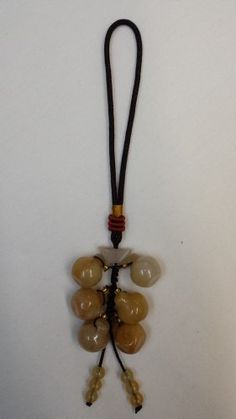 Amulet  Chinese Feng Shui Hand Carved Lucky Yellow Jade Ball Charms Money Talisman Cell Phone Charms Rear View Mirror Charm  Unexpected Miracles *** Check out this great product.