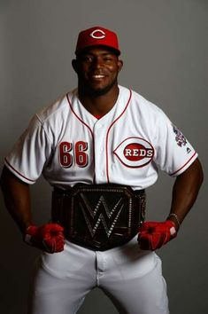 Cincinnati Reds: Cincinnati Reds right fielder Yasiel Puig poses for a photo with the WWE World Heavyweight Championship belt during media day at Goodyear Ballpark on February Yasiel Puig, World Heavyweight Championship, Red Y, Wwe World, February 19, Spring Training, Cincinnati Reds, Mlb, Poses