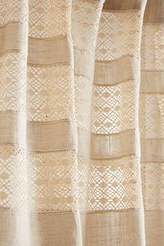 Anthro inspiration for sewing a custom curtain; insert a lace panel at top, or even at bottom, sew strips of main fabric over it to create pattern; Cadence Curtain - anthropologie.com