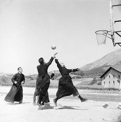 Brothers playing basketball