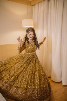 Real Indian Weddings - Shobit and Khushboo | WedMeGood | Twirling Bride in a Sequinned and Thread Work Gold and Copper Gown #wedmegood #twirling #realwedding #gold