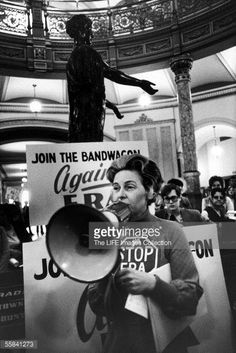 American political activist Phyllis Schlafly speaks to an audience through a megaphone as she opposes the passage of the Equal Rights Amendment (ERA) inside the rotunda of the state capitol building, Springfield, Illinois, March 10, 1975.