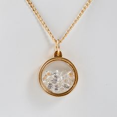 Delicate peekaboo lockets from Brazil hold treasure troves of precious minerals, luscious spice and sparkling crystals for all to see