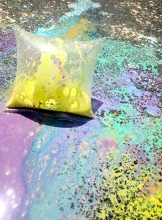 Exploding Sidewalk Chalk - FUN!--this looks totally awesome :) definitely great for outdoor play, and I imagine you could just hose down the pavement to wash it clean (though you might want to test that). I cannot wait to give this a shot :)