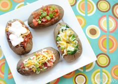 Baked Potato Bar // bake sweet and white potatoes, fill dishes with a variety of yummy toppings and you're set! #gameday #appetizer #foodbar