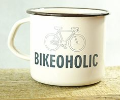 Light beige enamel mug with brown rim and engraved sentence: BIKEOHOLIC.  Vintage product but not used, crafted from steel with an enamel finish.