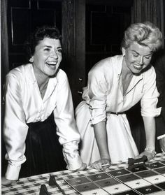 Doris Day in a candid moment at a party with Patty Lewis, Jerry Lewis' wife, in 1955.