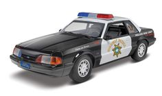 '90 Mustang LX 5.0 2 'n 1 1/25 scale plastic model kit from REVELL. Create the police package of this kit featuring a detailed 5.0 liter V-8 engine, quad shock suspension system, police light bar, radio and rear spotlights. # 85-4252