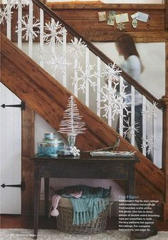 Painted wooden craft sticks were used to make this pretty snowflake garland. More Christmas garland decorations: Christmas Stairs Decorations, Winter Party Decorations, Decorating Banisters For Christmas, Winter Christmas, Christmas Home, Magical Christmas, Apartment Christmas, Winter Holidays, Christmas Holiday