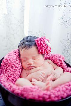 Newborn Kaylee.  I made the headband and blanket myself!