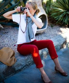 Consider wearing a white crew-neck tee and red chinos for a lazy Sunday brunch. For footwear go down the classic route with dark brown leather wedge sandals.   Shop this look on Lookastic: https://lookastic.com/women/looks/crew-neck-t-shirt-chinos-wedge-sandals/18145   — Blue Horizontal Striped Scarf  — White Crew-neck T-shirt  — Red Chinos  — Tan Leather Tote Bag  — Dark Brown Leather Wedge Sandals