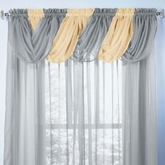 I think I like this (maybe a scarf valance instead of the toga) for the master bedroom