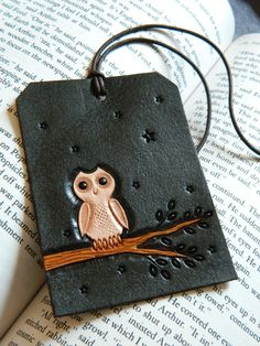 Leather Luggage Tag - White Owl - Hand Carved and Tooled - Original Starry Night Owl Design. $25.00, via Etsy.