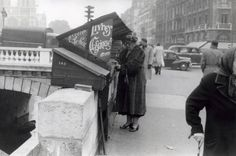 Agatha Christie, shopping for used books on along the Seine, Paris, January 1, 1955, uncredited