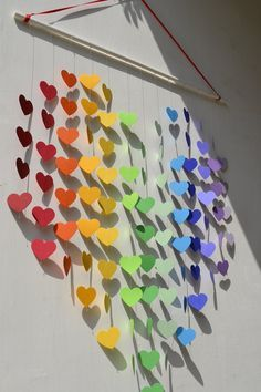 Large Rainbow Heart Mobile / Wall Hanging / Baby Shower / Unique Wedding Gift / Nursery Decor / Playroom / Birthday - MADE TO ORDER. $45.00, via Etsy. (try to make with Paint sample cards cut into hearts and placed back to back on string.)