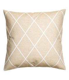 Cushion cover with a jacquard-weave front in a cotton blend containing glittery…