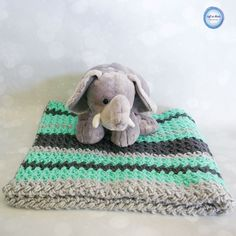 Make this fast and stunning baby blanket using Red Heart Soft Essentials  and the baby bean stitch. A blanket easy enough for a beginner with a  video tutorial to get you started!