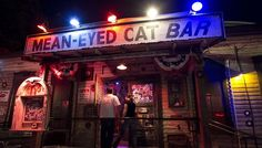 Inspired by Johnny Cash in both vibe and appearance, Mean Eyed Cat delivers craft beer, cocktails and good vibes in a dive bar setting on West 5th Street.