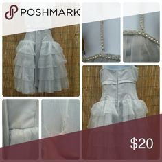 Party dress Beautiful layered dress wish studded details. has a few stains on it but should be easily washed out. has a bow in front very cute dress almost feel like Cinderella on her way to the ball Dresses Midi