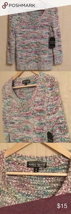 Colorful Sweater! Soft blend, multi-colored sweater. Scoop neck and full length sleeves. It is very comfortable and soft! Super cute with jeans and boots for a laidback, cute look.  Almost Famous Sweaters Crew & Scoop Necks