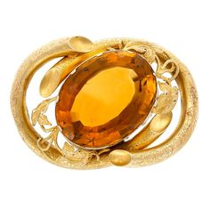 Antique Gold and Citrine Brooch  One oval citrine ap. 59.00 cts., ap. 16.7 dwts. Probably Victorian