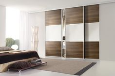 Silver frame with walnut panels, pure white glass and silver horizontal split bars.
