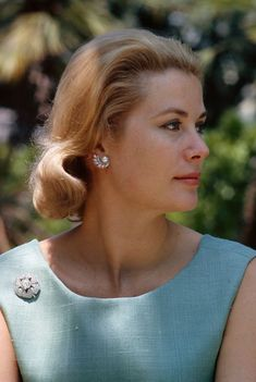 Princess Grace wearing a brooch
