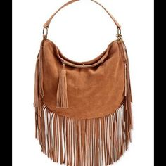 "Lucky Brand Rickey Suede Fringe Designed for the boho girl on the go, this suede hobo bag rocks a full layer of fringe and an optional crossbody strap. By Lucky Brand. Leather; lining: cotton Handle with 5-1/2"" drop; shoulder strap with 22"" drop Magnetic snap closure Exterior features antique brass-tone hardware, 1 front zip pocket with tassel pull and detachable logo fob Interior features 1 zip pocket and 2 slip pockets 12-1/4"" W x 14-1/2"" H x 1/4"" D ☺️️️️price negotiable Lucky Brand Bags…"