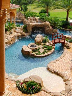You can now have the pool that you dream about without the bother of day-to-day upkeep! It is all kind lazy river pool you'll only find in here. Lazy River Pool, Backyard Lazy River, Backyard Paradise, Modern Backyard, Walk In Pool, Backyard Beach, Beach Pool, Ponds Backyard, Backyard Landscaping