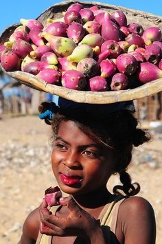 """In Madagascar: """"My lips are red, because I could not stop! I decided to eat ONE while I waited for you, but you took a long time 'Chenzira.'  Now can you guess how many I have eaten?!"""""""