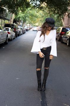 fall outfits, fall transition style, how to dress for fall in nyc, nyc top blogger, elle harper, elle harper blog, blogger style, nyc style, white sweater, black and gold gucci belt, how to style gucci belt for fall, how to style white sweater, how to style black jeans, black ripped jeans, nyc street style, new york fashion week, long brown hair style, black booties, free people style, free people fall, bell sleeve sweater, white bell sleeve sweater, black lieutenant hat, cute sweater