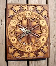 Han Carved Relief Clock: Hand carved clock, ornate flower design with shaded stain / Carver