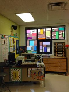 Art With Mrs. J: Art Room Windows! Tissue paper attached with glue stick on windows; electrical tape along edges to create leaded-look