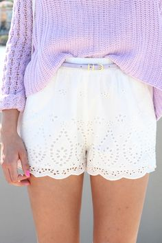eyelet shorts and lavender sweater.
