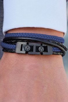 Add some mystery to your day with this strong black and blue double wrap leather bracelet. Blue braids are superfiber cords, black strands are genuine leather. The stainless steel double lock promises a secure fit, and can adjust smaller by removing the Blue Aesthetic, Blue Butterfly, Bracelet Designs, Bracelets For Men, Blue Bracelets, Black And Brown, Double Lock, Watches For Men, Men's Watches
