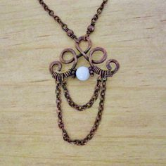 Hammered Antiqued Copper Wire Wrapped Necklace with Mother of Pearl center and chain dangles