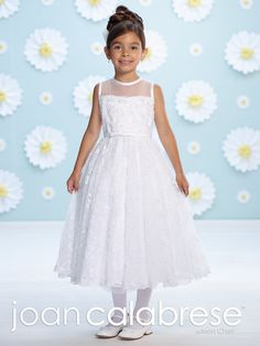 (7 Tea Length, White) This precious First Communion gown is the must have style this season! The modern sleeveless dress is made of satin and hand-beaded embroidered tulle. It has an elegant bodice with an illusion neckline and satin banding. The satin waistband separates the bodice and skirt and has a center bow which forms a lovely focal point. An illusion keyhole back adorns the back of the gown and a softly gathered tulle overlay skirt with scalloped lace hem completes the darling look…