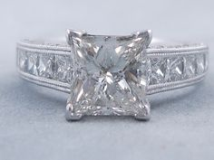 This is our sparkly 3.29 ctw Princess Cut Diamond Engagement Ring that has a stunning 2.02 carats Princess Cut H Color/SI2 Clarity (Clarity Enhanced) Center diamond. It is set in 14k White Gold with 1.27 cts of Round Brilliant and Princess Cut accent diamonds in a beautifully crafted setting, listed for $8,990. Drop Dead Gorgeous, Princess Cut Diamonds, Diamond Are A Girls Best Friend, Fashion Rings, Diamond Engagement Rings, Dream Wedding, White Gold, Bling, Wedding Rings