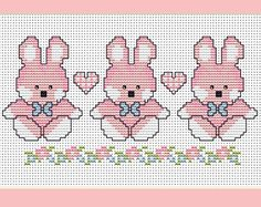 Baby Girl Bunnies or Easter Bunnies Cross stitch chart ( full colour and black and white ) with instructions and full colour picture This delightfully easy cross stitch design would make a great card or framed picture for a little girl, it would also ma Baby Cross Stitch Patterns, Cross Stitch For Kids, Simple Cross Stitch, Cross Stitch Borders, Cross Stitch Baby, Cross Stitch Samplers, Cross Stitch Designs, Cross Stitching, Cross Stitch Embroidery
