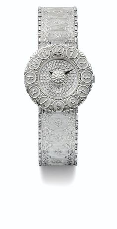 BUCCELLATI A LADY'S WHITE GOLD BRACELET WATCH CASE 0022 ELIOCHRON CIRCA 2008 • quartz movement • engraved dial • 18k white gold case, flower-shaped bezel with engraved Arabic numerals, engraved flower to the centre of the dial • 18k white gold ingrated patterned bracelet .