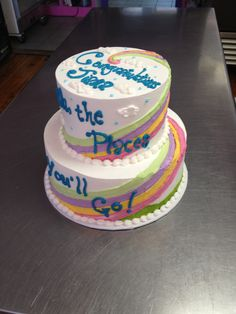 Dr. Seuss 'Oh the places you'll go' graduation tiered cake. Wild Flour Bakery.