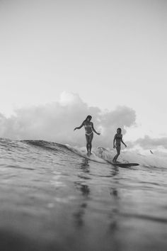 Afternoons spend surfing in the sea.
