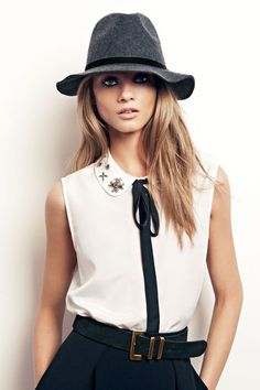 Slouch hat, white top, black tie and slacks