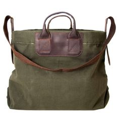 Tote by United By Blue, an expert in conscientious accessories, crafted from 100% organic cotton canvas and features leather handles and a removable canvas and leather dark brown strap. Carry handles mounted on leather patch.