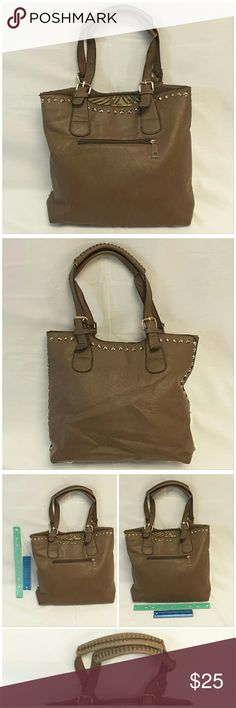 "Offers of 40% Less on BUNDLES Always Accepted! Leather-look Large Handbag, lots of compartments, goldtone hardware, adjustable buckle straps reinforced at top center,   man made material, approximate measurements: 12"" tall, 14"" length, 4"" wide, 8"" from top zipper to center straps, 1 zipper outside pocket, Inside: 2 large buckets, center zipper, 2 side wall pouches, 1 side wall zipper.  rulers for reference only (blue is 6"", green is 12"") ADD TO A BUNDLE!   Offers of 40% Less on BUNDLES…"