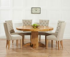 Torino 150cm Solid Oak Round Pedestal Dining Table with Anais Fabric Chairs