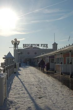 Brighton Pier in the snow: the owners changed the sign from Palace Pier in 2000 (an informal name change not recognised by the National Piers Society or many Brightonians). The full name of the pier is 'Brighton Marine and Palace Pier' Brighton Beach Uk, Brighton East Sussex, Brighton England, Brighton And Hove, Homes England, City By The Sea, Staycation, Dream Vacations, Seaside