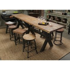 This distressed wooden table looks beautiful in your rustic decor styled home. Enjoy making memories with family and friends while dinning around this table.