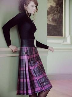 Scottish-styled skirt, with black, long-sleeve top, and big black belt. Chic and gives a shout-out to Scottish traditional wear. Cute!